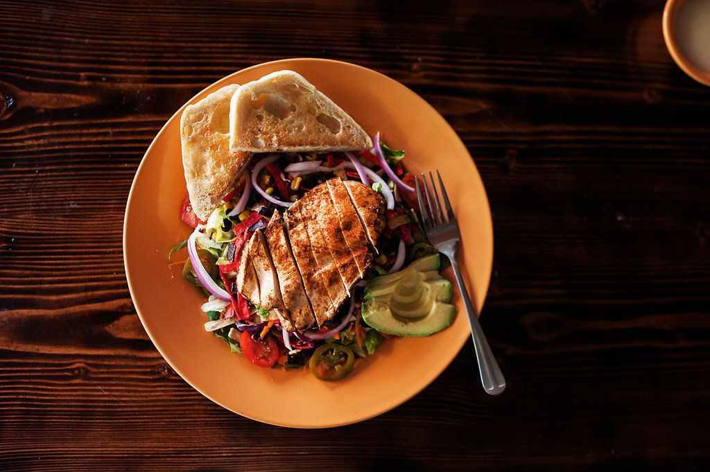 Colorful image of the Southwestern Chicken Salad on a wooden table looking mighty tasty